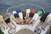 Group of looking over bow of a boat — Stock Photo