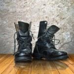 Old black boot on wood floor — Stock Photo #3943908