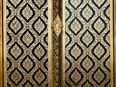 Thai gold art painting on wood door — Stock Photo