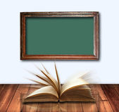 Open book on wood table — Stock Photo