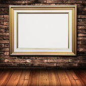 Gold frame on brick wall — Stock Photo