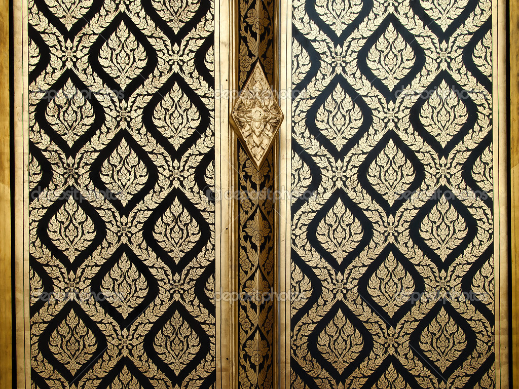 Thai Design Wallpaper : Thai gold art painting on wood door stock photo