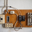 Foto Stock: Electrical in wood panel