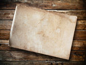 Old paper on panel wood — Stock Photo