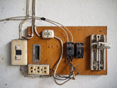 Electrical in wood panel — Stock fotografie