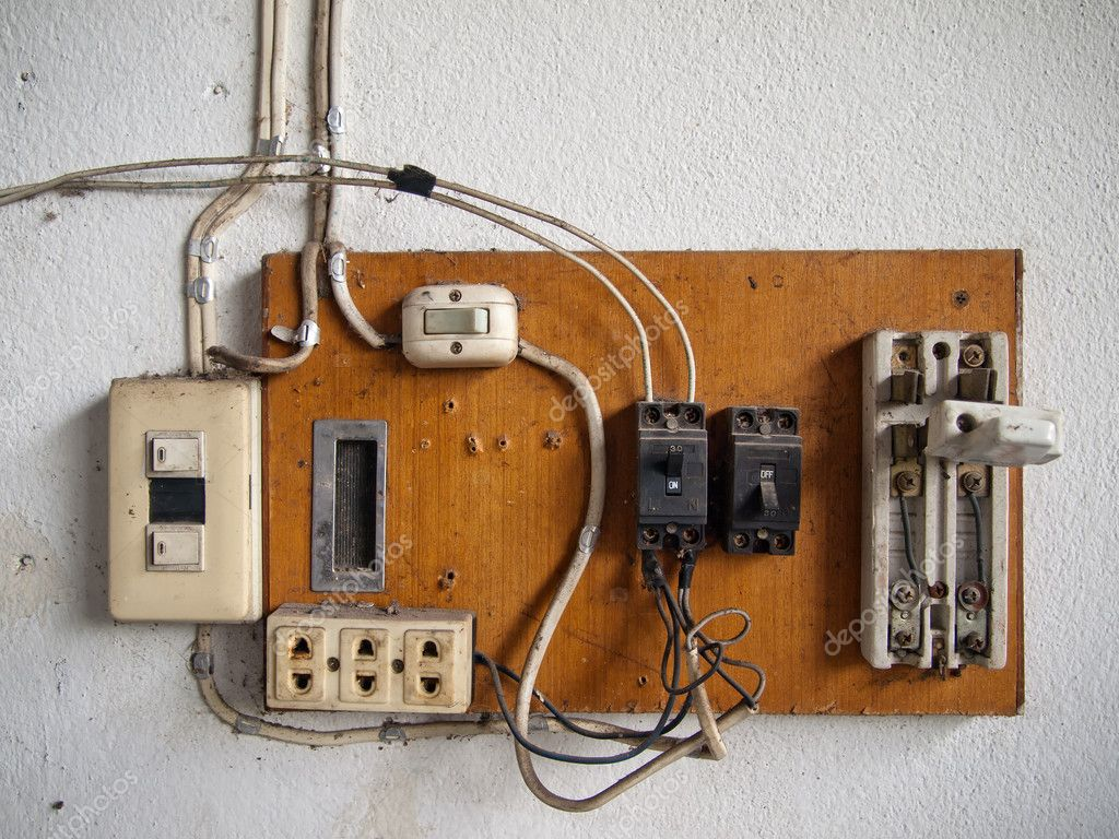 Old dirty Electrical in wood panel on wall  Stock Photo #4015478