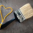 Paint brush with a yellow rope — Stock Photo