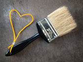 Paint brush with a yellow rope — Zdjęcie stockowe