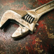 Royalty-Free Stock Photo: Old Wrench on the fuel tank