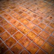 Square red tiles floor — Stock Photo #4140232