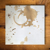 Coffee stains on blank white paper — Stock Photo