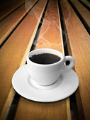 White ceramic of coffee on wood — Stock Photo