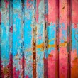 Red and blue color paint on metal wall — Stockfoto