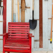 Royalty-Free Stock Photo: Red chair. In front of the old wooden walls.
