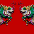 Twin Chinese Dragon statue isolated on red — Stock Photo