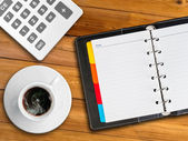 White notebook and white cup of hot coffee — Stock Photo