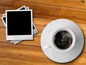 White cup of hot coffe and photo frame — 图库照片