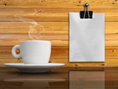 A white cup of coffee and white paper — Stock Photo