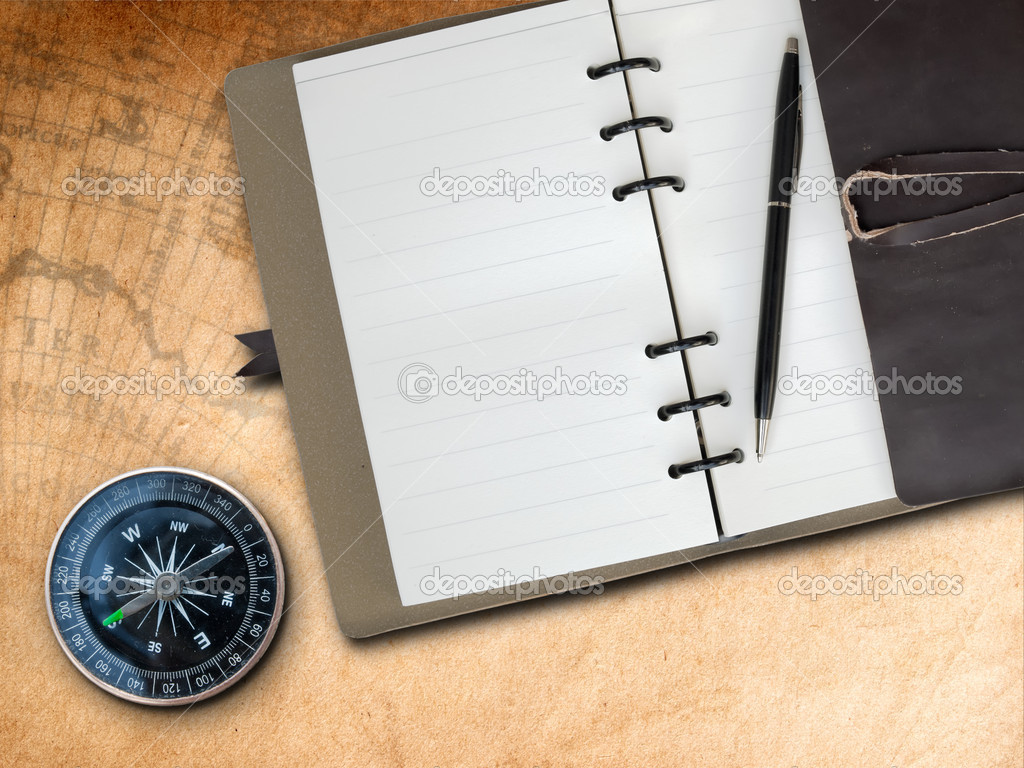 Black pen with Brown Leather cover note book and Compass on old map background — Stock Photo #5251782