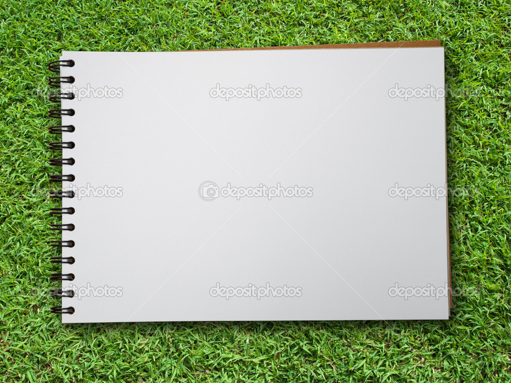 White blank note book on green grass background — Stock Photo #5252001