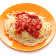 Spaghetti and meat with ketchup in orange plate — Stock Photo