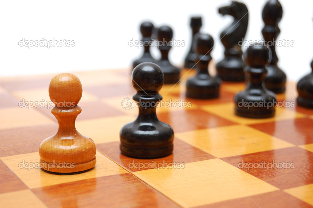 One white pawn fights against black army on chess board. — Stock Photo #3980737