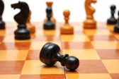 Black pawn is killed on chess war — Stock Photo