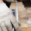 Hands in protective gloves with pen and Metre measure ruler — ストック写真