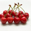 Red riped cherry on linen background — Stock Photo