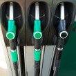 Gas nozzles at the gas station — Stock Photo #4573021