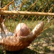 Stock Photo: Relaxation in the hammock