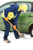 Man digging car wheels from the snow — Stock Photo