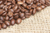 Coffee beans on bagging material — Stock Photo