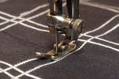 Old stitching machine stitch checked material — Stock Photo