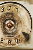 Grunge: rotary dial of old broken phone — Stock Photo