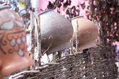 Handmade earthenware in wattle. Ukrainian culture. — Stock Photo