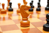 Knight chessman on chess board — Stock Photo