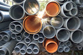 Grey and orange plastic pipes — Stock Photo