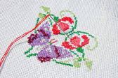 Needlework. Cloth with needle, thread and embroidered batterfly — Stock Photo