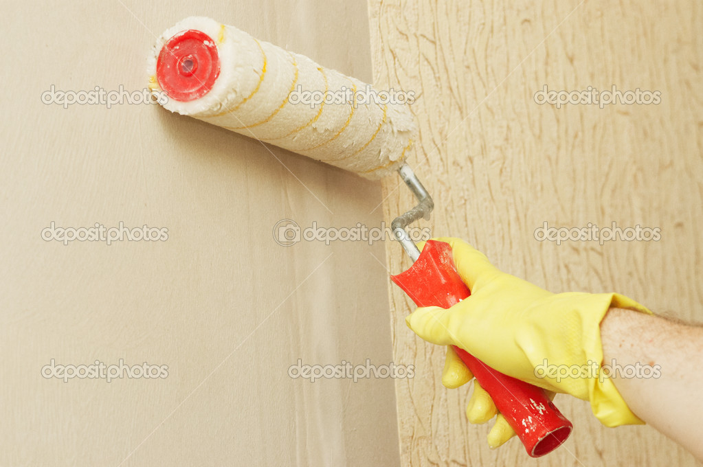 Main dans la glothes mur lubrifiante sur la colle pour for Colle pour papier peint