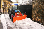 Bulldozer shoveling snow — Stock Photo