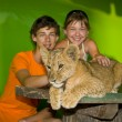 Stock Photo: Guy, girl and young lion