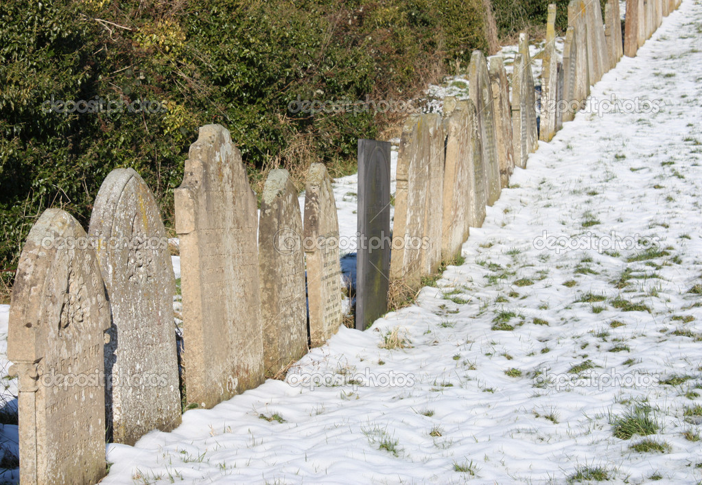 Headstones in a Snow Covered Graveyard. — Stock Photo #4492080