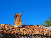 Old tiled roof with a small chimney — Stock Photo
