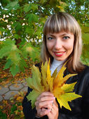 Portrait of a beautiful woman with leaves — Stock Photo