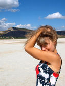Portrait of pretty girl on a salt lake — Stock Photo