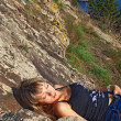 Beautiful girl lying on the mountain — Stock Photo