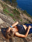 Beautiful girl lying on the mountain — Stock Photo