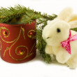 Toy rabbit, red candle and fir branches isolated — Stock Photo
