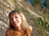 Smiling blonde girl on a mountain — Foto Stock
